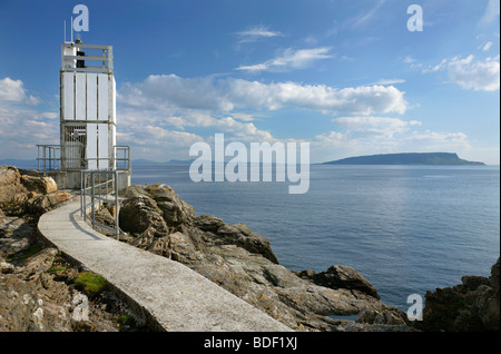 Point of Sleat Lighthouse and the Isle of Canna, Isle of Skye, Scotland. - Stock Photo