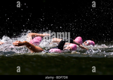 Swimmers compete in an Xterra triathlon. - Stock Photo