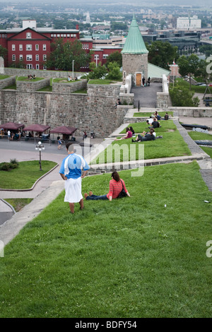 People hang out on top of the city walls in Quebec city - Stock Photo