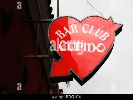 Heart shaped neon sign outside bar called 'Cupido' in Spain - Stock Photo