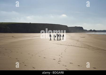 Surfers on a beach - Stock Photo
