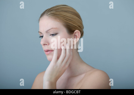 PAINFUL TOOTH IN A WOMAN - Stock Photo