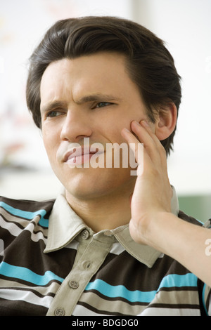 MAN WITH TOOTHACHE - Stock Photo