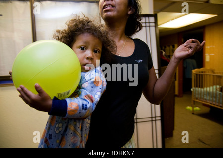 Selena Pina, a homeless mother of four, gets her children ready for school at the Family Promises Center in Sacramento, - Stock Photo