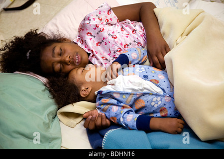 Selena Pina, a homeless mother of four, starts her day at 6am by coaxing her children to get up and ready for the - Stock Photo