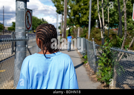 Selena Pina, a homeless mother of four, takes a walk in the afternoon with her children in Sacramento, CA. - Stock Photo