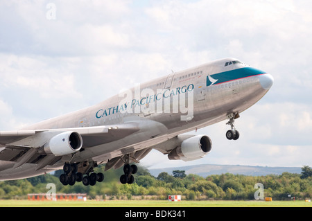 Boeing 747-412BCF B-HKS in the livery of Cathay Pacific Cargo takes off from Manchester Airport - Stock Photo