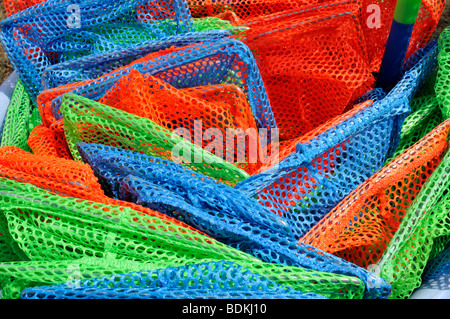 Close up concept shot of colorful childrens plastic fishing nets - Stock Photo