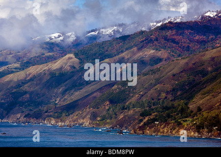 A clearing storm reveals the snow-capped Santa Lucia Mountains and the Big Sur Headlands, California, USA. - Stock Photo