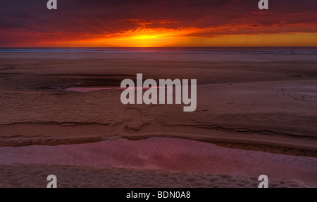 A clearing winter storm provides a beautiful dusk sky at Pismo State Beach, Pismo Beach, California, USA. - Stock Photo