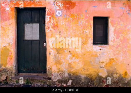 An old wall with distressed paint - Stock Photo