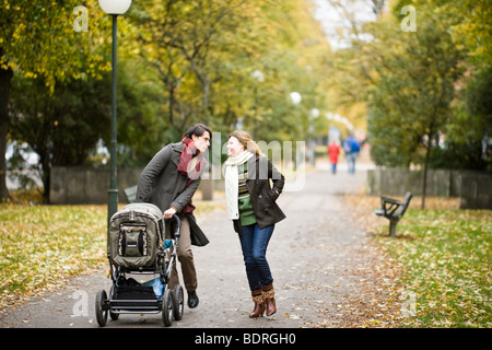 A couple taking a walk with their son - Stock Photo