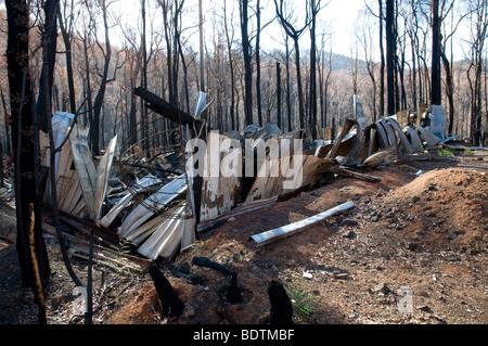 Charred corrugated iron after a bushfire, Marysville, Victoria, Australia - Stock Photo