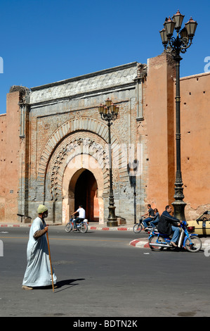 A Moroccan Man Wearing a Traditional Jellaba Walks Past the Bab Agnaou Gate in the City or Town Walls of Marrakesh, - Stock Photo