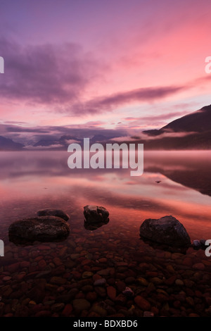 Sunrise over lake McDonald, Glacier National Park - Stock Photo