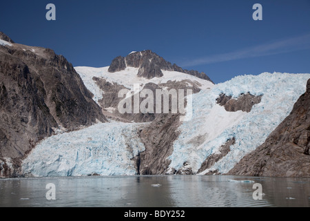 Seward, Alaska - Northwestern Glacier spills into Northwestern Fjord in Kenai Fjords National Park. - Stock Photo