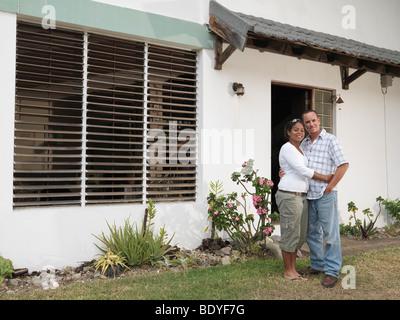 Couple Outside White House - Stock Photo