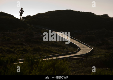 Young Woman Running on Boardwalk - Stock Photo