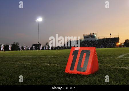 Football field at the 10th yard at night - Stock Photo