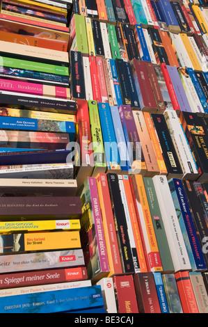 Modern antiquarian bookshop, soft-covers, bookspines, full-frame - Stock Photo