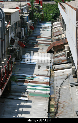 Corrugated metal roof tops on a backstreet , Central Bangkok , Thailand - Stock Photo