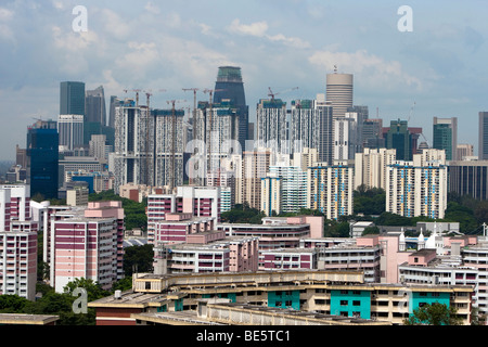 Singapore skyline, skyscrapers with cheap housing, behind the expensive central business district of Singapore, - Stock Photo