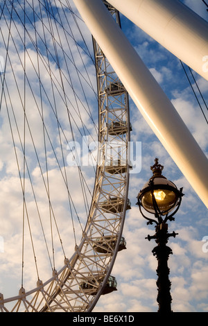 London Eye ground view Southbank Thames London street lamp post clouds evening summertime sunset Europe capital - Stock Photo