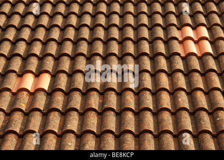 replacement tiles on roof - Stock Photo