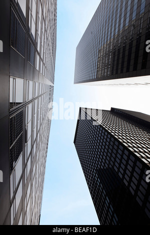 Low angle view of skyscrapers, Manhattan, New York City, NY, USA - Stock Photo