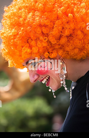 Woman wearing orange wig in festival parade Palma Mallorca Spain - Stock Photo