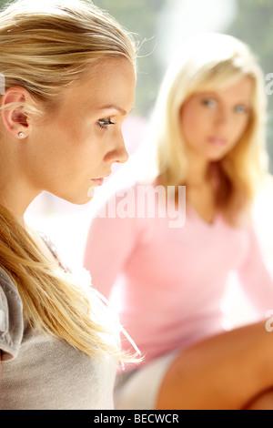 2 woman thoughtful - Stock Photo