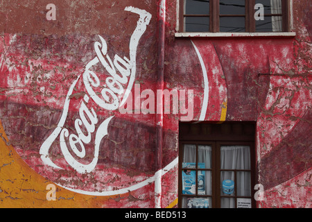 Advertising mural for coca cola on the wall of a store in for Coca cola wall mural