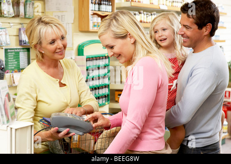 Shop assistant is serving a customer stock photo royalty for Assistant cuisine