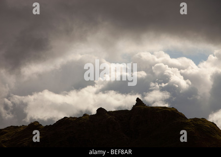 Walkers on Helm Crag above Grasmere in the Lake District, UK. - Stock Photo