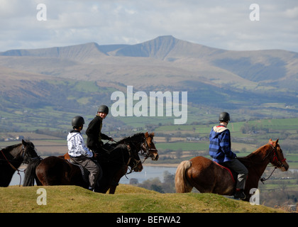 Horse riding near Llangorse in the Black Mountains looking towards Pen y Fan in the Brecon Beacons - Stock Photo