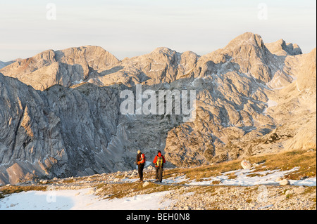 View from Dom Planika with two walkers, Julian Alps, Slovenia. - Stock Photo