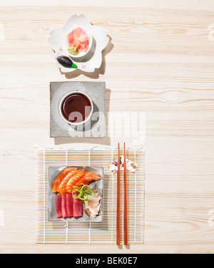 sushi served with ginger, soy sauce, wasabi and miso - Stock Photo