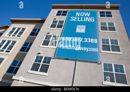 A close up of an advertising sign selling premises in a mixed used housing development. Millbrae, CA, USA - Stock Photo