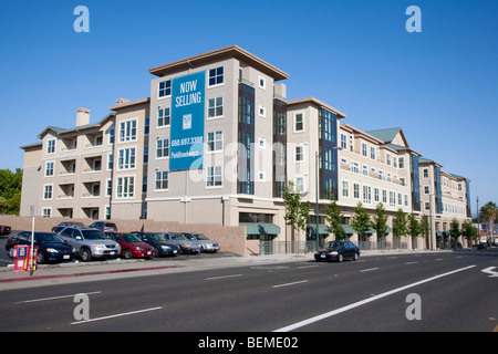 An advertising sign on a newly built mixed use building by a road. Park Broadway, El Camino Real in Millbrae, CA, - Stock Photo