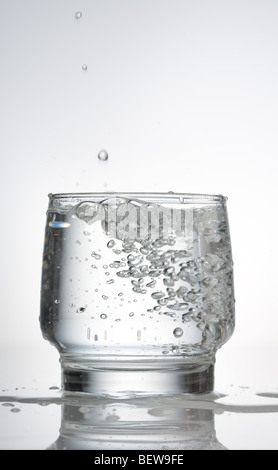 carbonated water in a glass, close-up - Stock Photo