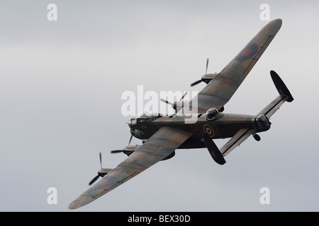 Avro lancaster in flight at Imperial War Museum, Duxford, Cambridgeshire, England, United Kingdom - Stock Photo