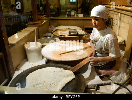 Grand Bazaar Kapali Carsi Kapalıcarsı Istanbul Turkey Woman Bakery Bread  bakehouse pancake - Stock Photo