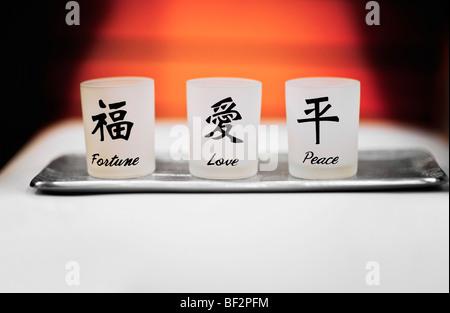 Votive glasses of Fortune, Love and Peace - Stockfoto