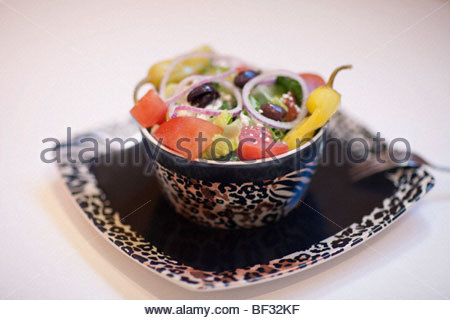 Close-up of a salad with peppers and olives - Stock Photo