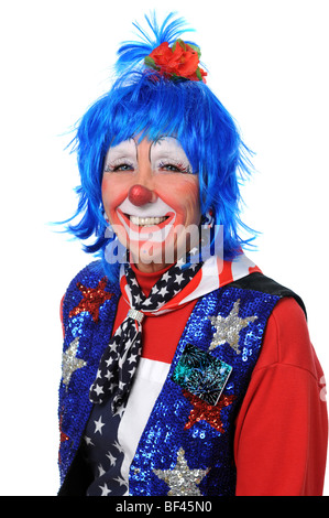 Clown dressed in red, white and blue smiling - Stock Photo