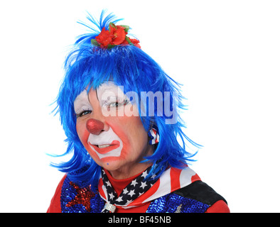 Portrait of clown dressed in red, white and blue - Stock Photo