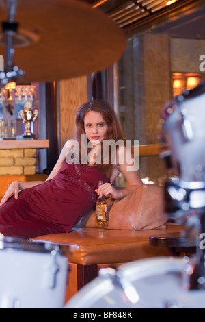 girl in nightclub, drums in foreground - Stock Photo