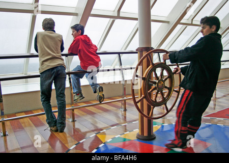 three young boys playing on the ferry from Hoek van Holland to Harwich - Stock Photo