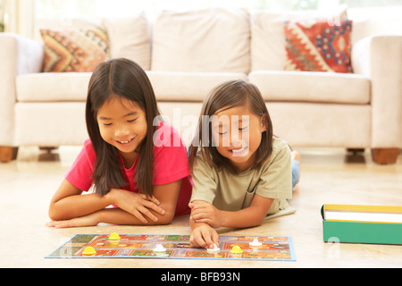Two Girls Playing Board Game At Home - Stockfoto
