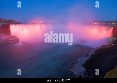 Horseshoe Falls along the Niagara River at dusk during the nightly illumination, Niagara Falls, Ontario, Canada - Stock Photo